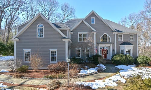 Six bedroom colonial home in Westborough MA - gray with white trim and red door