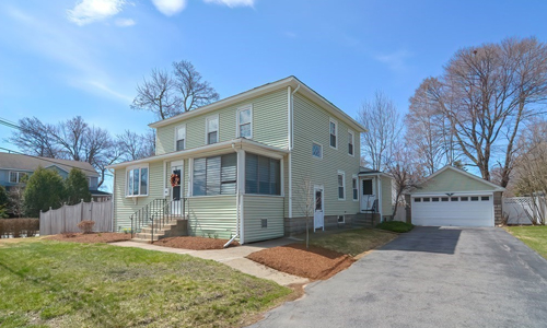 Four bedroom colonial home in Shrewsbury MA - light green with white trim, enclosed porch and detached garage