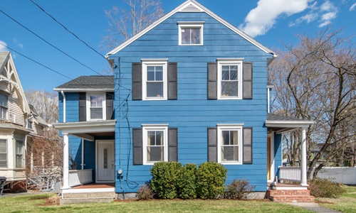 Four bedroom colonial home in Westborough MA - blue with white trim, white door and black shutters