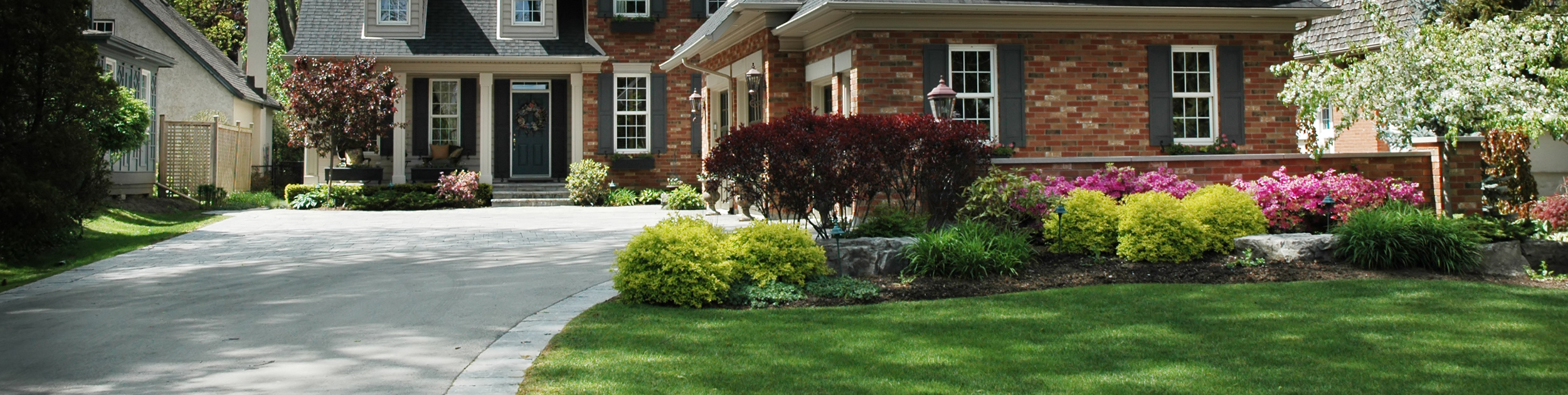 luxury home with Spring bushes blooming outside