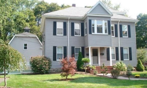 Four bedroom Colonial for sale in Natick, MA - exterior view of home shown