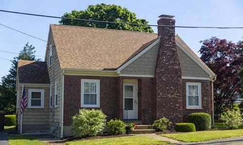 exterior image of Detached Beige Cape for sale with brick front and chimney