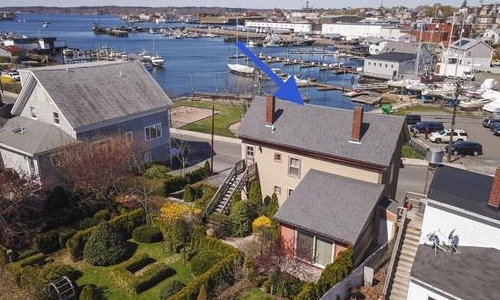 Detached Gold Colonial with view of Gloucester Harbor