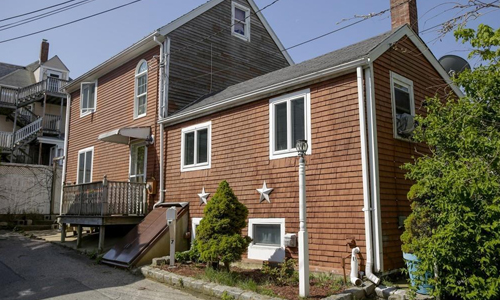Detached Brown Colonial for sale in Gloucester MA - exterior of home shown
