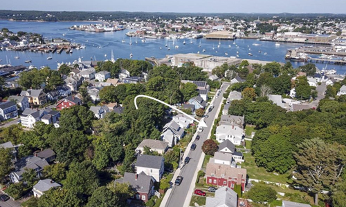 Four bedroom colonial for sale in Gloucester MA - exterior of building shown with arrow showing the location as it is close to the ocean