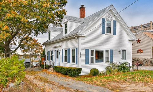 Two bedroom cape for sale in Gloucester MA - exterior of home shown, white with blue trim