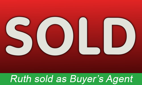 red and white SOLD sign