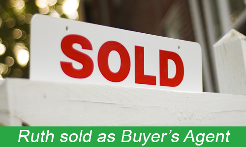 red and white wooden SOLD sign