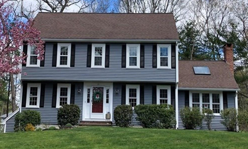 Detached Grey Colonial for sale in Hanover, MA - exterior of home shown